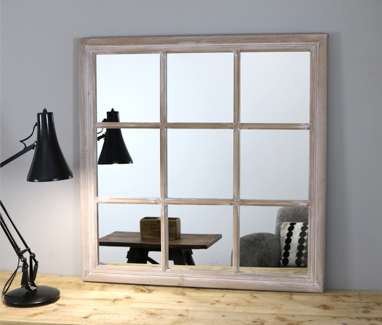 A well-placed mirror dramatically extends a smaller home office.