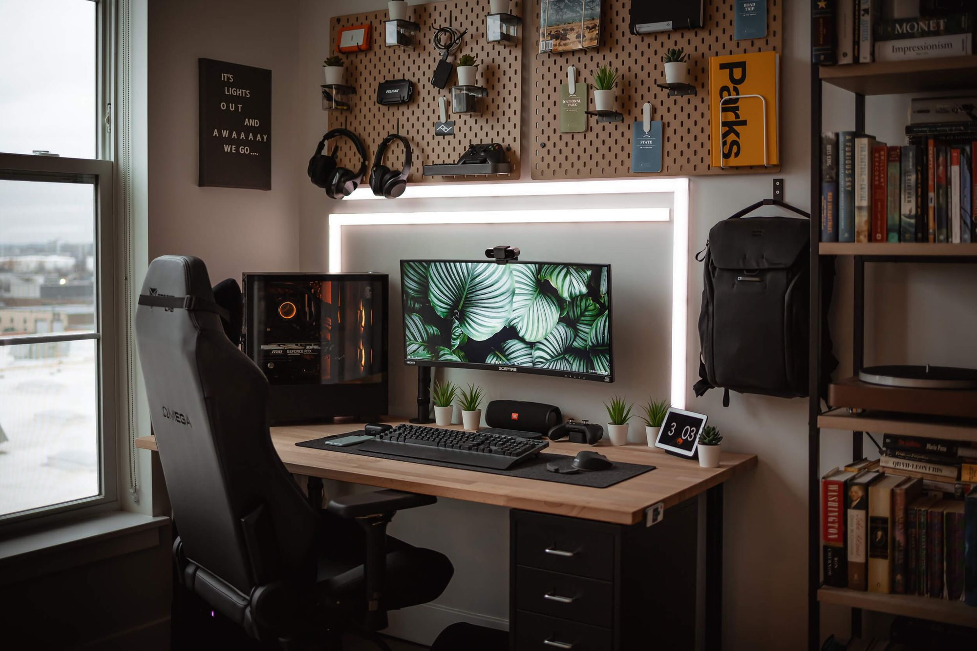Cam's versatile maker station serves him as a workspace, battle station, and so much more