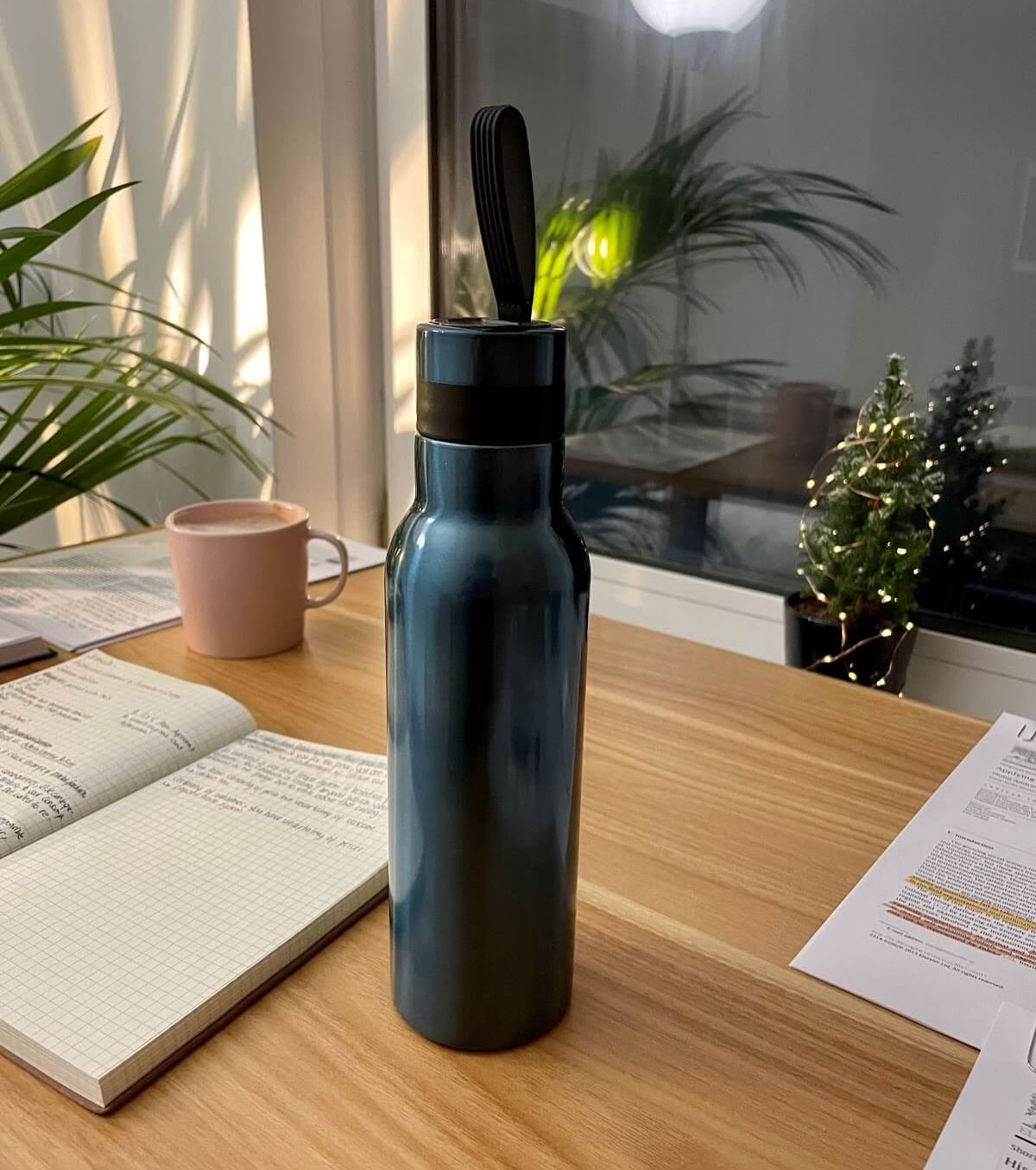 Merve's teal water bottle takes a prominent space on her desk