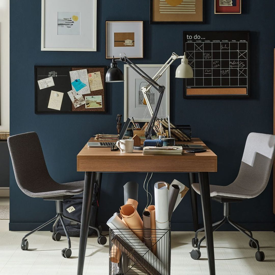 Dark and stylish 'mirrored' face-to-face home office with a flexible desk