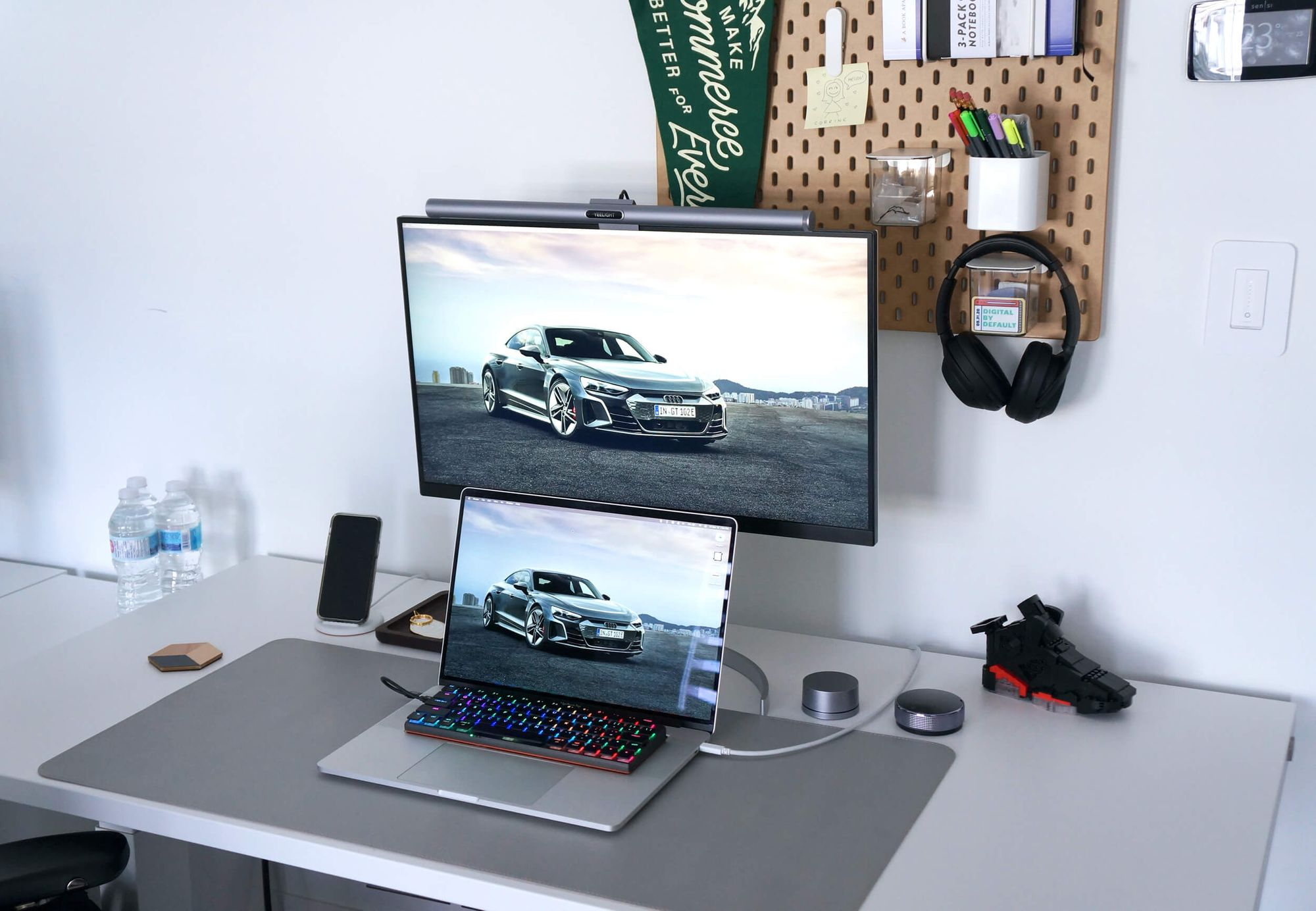 Kevin says that minimal look but high functionality for storing things help keep his desk clean and tidy