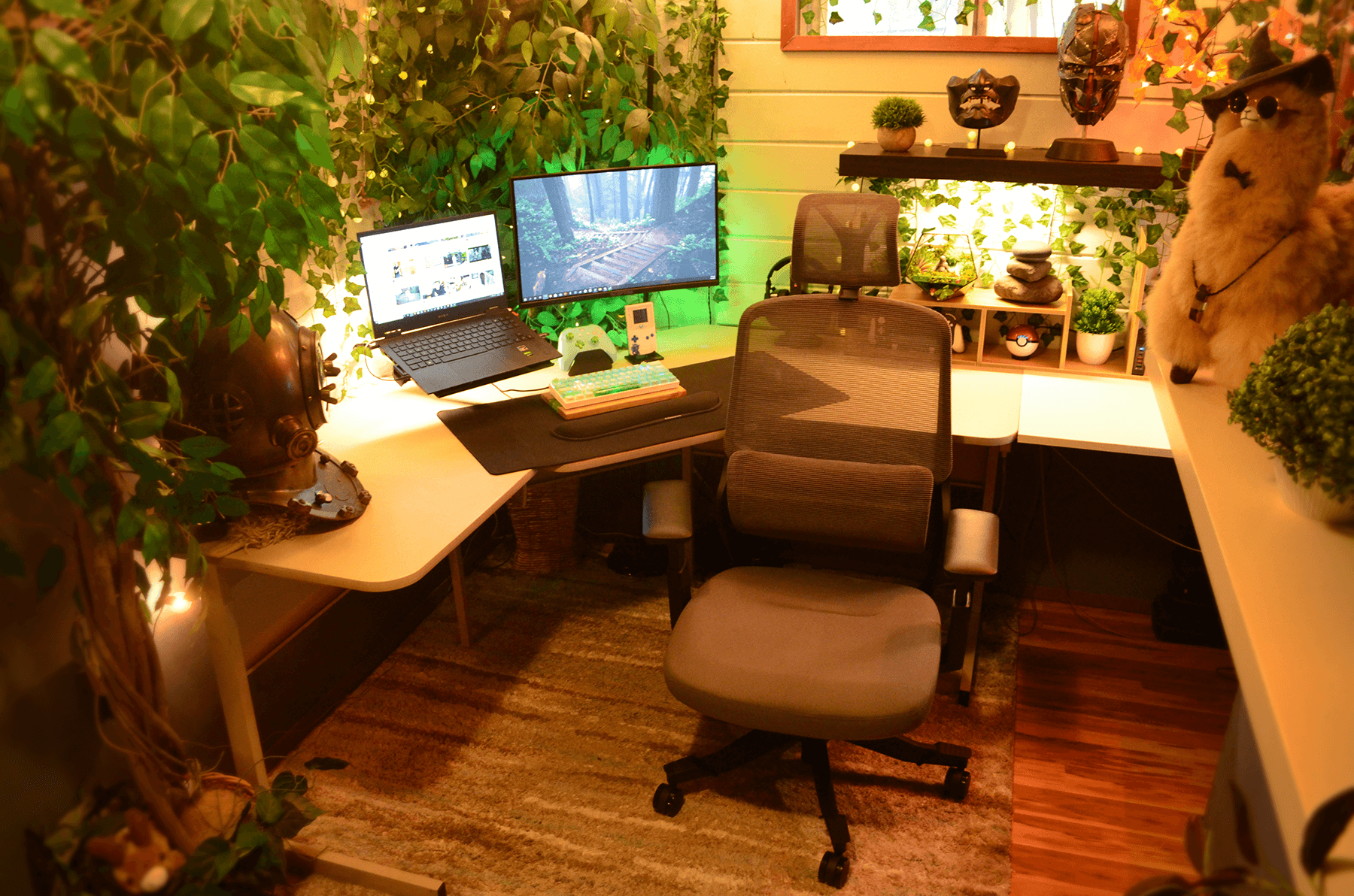 A WFH setup with lots of plants and an alpaca wearing a hat and sunglasses